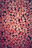 Tiny red hearts on dark background stock image
