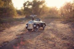 Tiny rider toy car Royalty Free Stock Image