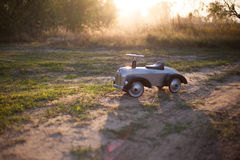 Tiny rider toy car Royalty Free Stock Images
