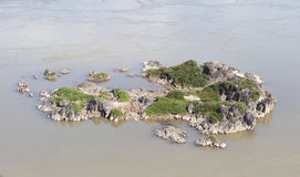 The tiny rocky islets in river. Royalty Free Stock Images
