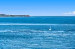 Tiny sailboat on the Atlantic Royalty Free Stock Photos