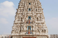 Tiny sculptures of gods on top of a Hindu temple Royalty Free Stock Image