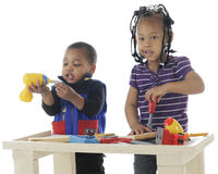 Tiny Sibling Carpenters Stock Photo
