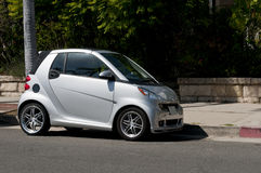 Tiny Smart Car. A tiny, silver, subcompact Smart Car, parked on a residential street Stock Images
