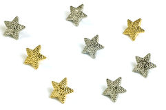 Tiny stars. Tiny gold and silver stars isolated on white background Stock Image