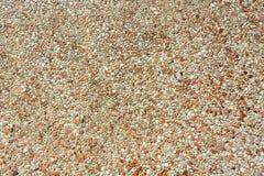 Tiny stone mosaic wall background. Tiny brown stone wall background Royalty Free Stock Image