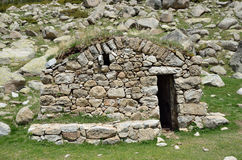 Tiny stone refuge in the mountains. The small refuge is built from stones in the upper part of the Vall-de-Madriu-Perafita-Claror Stock Image