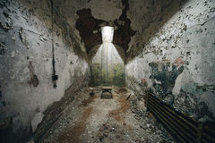 Tiny stool in an abandoned prison cell. Prison cell in Eastern State Penitentiary Stock Image