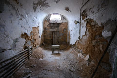 Tiny stool in an abandoned prison cell. Prison cell in Eastern State Penitentiary Stock Photography