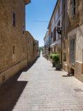 Tiny street in Arta Stock Photography