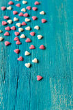 Tiny sugar hearts on emerald  table Stock Photography