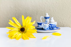 Tiny tea set and flower Stock Image