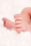 Tiny Toes. Close up of a newborn's feet on a fluffy white blanket Royalty Free Stock Photos