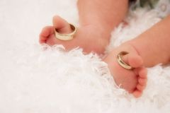 Tiny Toes with Wedding Rings Stock Photo