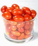 Tiny tomatoes. Tiny tomatoes on white background Stock Image