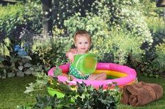 Tiny Tot in Tiny Pool Stock Photo