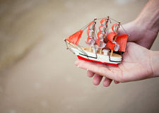 Tiny toy boat symbolizes the new life of a young family Royalty Free Stock Images