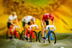 Tiny toy cyclists Royalty Free Stock Images