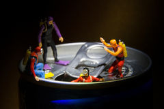 Tiny toy Divers explore Royalty Free Stock Photos