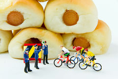 Tiny toys businessman and Sausage bread.Concept food background. Royalty Free Stock Photography