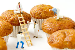 Tiny toys cleaning banana cake.Food background Royalty Free Stock Photo