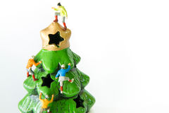 Tiny toys climbing on the Christmas tree. Royalty Free Stock Photography
