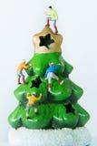 Tiny toys climbing on the Christmas tree. Royalty Free Stock Image