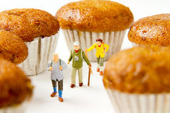 Tiny toys travelers adventure travel and banana cake.Food backgr. Ound Stock Image