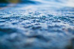 Tiny water bubbles on surface of blue wave macro royalty free stock photos