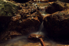 Tiny waterfall. Longtime exposure of a little stream Royalty Free Stock Photography