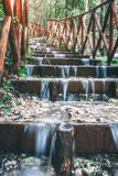 Tiny Waterfalls Italy Matese Mountains. Tiny waterfalls along a bridge extending to the top of the waterfall-lined path near Matese Park, Italy stock images