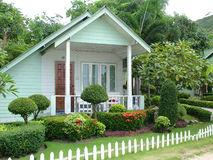 Tiny White Cottage. A Small Holiday Cottage with garden Stock Photography