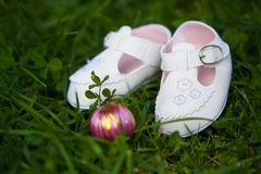 Tiny white shoes for baby girl Royalty Free Stock Image