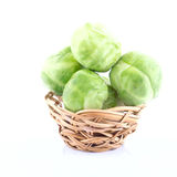 Tiny wicker with the raw Brussels sprout Stock Photography
