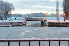 Tiny wooden bridge over the frozen canal. Klaipeda, Lithuania Stock Photography