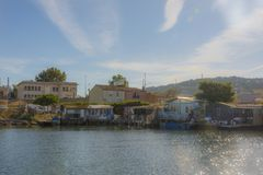 The fishers corner in Sete France. The tiny wooden houses in Sete France mask the delight of fishers cooking that attracts visitors who enjoy fresh fish along Stock Photos