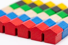 Free Tiny Wooden Toy Houses Painted In Different Colors Stock Photography - 193181822