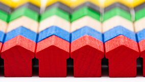 Free Tiny Wooden Toy Houses Painted In Different Colors Stock Image - 193181881