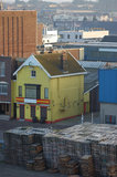 Yellow house. Tiny yellow house among stacked skids at Ijmuiden harbor nearby Amsterdam Royalty Free Stock Photos