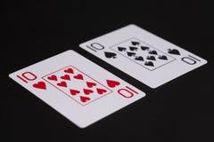Tio av spadar och tio av hjärtor som spelar kortet Royaltyfria Bilder