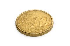 Tio eurocent mynt som isoleras på vit bakgrund Arkivbild