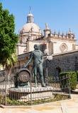 Tio Pepe雕象在大教堂附近的赫雷斯de la的弗隆特里,西班牙 库存图片