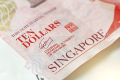 Tio Singapore dollar med en anmärkning 10 dollar Fotografering för Bildbyråer