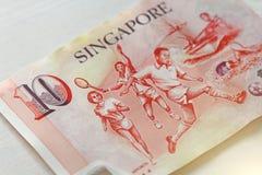 Tio Singapore dollar med en anmärkning 10 dollar Arkivbilder