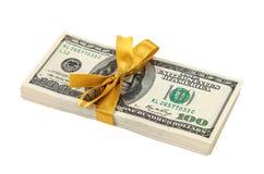 Tio tusen dollarhögar av hundra dollarräkningar Fotografering för Bildbyråer