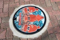 Tioarmad bläckfiskrörlock Arkivfoto