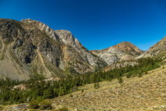 Tioga Pass. El. 9,943 ft.  is a mountain pass in the Sierra Nevada mountains of California. State Route 120 runs through it, and serves as the eastern entry Stock Image