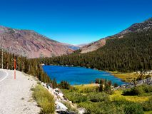 Tioga Pass Lake Sierra Nevada Mountains. Beautiful Tioga Lake is located in the magnificent Eastern Sierra Nevada Mountains. Tioga Pass Road, California Stock Image