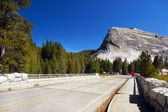 Tioga Pass Road, Yosemite Granite Monolith. Lembert Dome 2,871 m and bridge on Tioga Pass Road. Yosemite National Park. California United States Royalty Free Stock Image