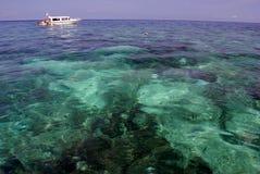 Tioman Island, Malaysia. Single boat on a tropical sea Royalty Free Stock Image